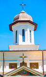 Orthodox curch tower on blue sky. Orthodox church tower during a sunny day in Romania Royalty Free Stock Photography