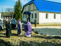 Orthodox divine service near the temple in the Kaluga region in Russia (2014). Very often, Orthodox services in the Russian Orthodox Church are held not only stock images