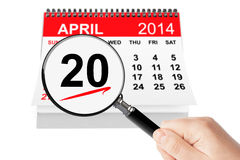 Orthodox Easter Concept. 20 april 2014 calendar with magnifier on a white background Royalty Free Stock Image