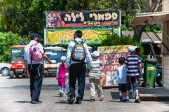 Orthodox family walking together towards Safari Ramat-Gan Park in Israel stock photo