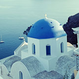 Orthodox greek church in the Oia village, Santorini, sea view. Orthodox greek church in the Oia village, Santorini, Greece. Square toned image, instagram effect Royalty Free Stock Photography