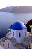 Orthodox greek church in the Oia village, Santorini, sea view. Royalty Free Stock Image