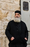 Orthodox Greek priest. Outside the Church of the Holy Sepulchre royalty free stock photo