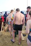 Orthodox holiday baptism in Russia a crowd of naked people plunge into the icy water in winter Novosibirsk January 19, 2019 royalty free stock photography