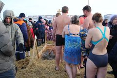 Orthodox holiday baptism in Russia a crowd of naked people plunge into the icy water in winter Novosibirsk January 19, 2019 stock photos