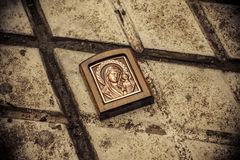 Orthodox icon on the ground. One of attributes of religion Stock Photo