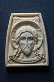 Orthodox icon of mammoth ivory handcrafted. Royalty Free Stock Images