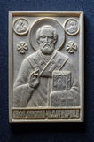 Orthodox icon of mammoth ivory handcrafted. Stock Photos