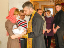 Orthodox infant baptism ceremony at home in Belarus. The baptism of newborn infants is the main ritual in Christianity and the Orthodox Church. It can also be Royalty Free Stock Photography