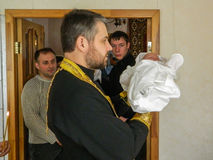 Orthodox infant baptism ceremony at home in Belarus. Stock Images