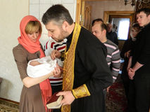 Orthodox infant baptism ceremony at home in Belarus. Royalty Free Stock Photography