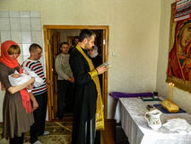 Orthodox infant baptism ceremony at home in Belarus. Stock Photo
