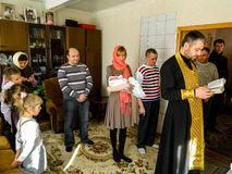 Orthodox infant baptism ceremony at home in Belarus. Royalty Free Stock Image
