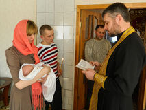 Orthodox infant baptism ceremony at home in Belarus. Royalty Free Stock Images