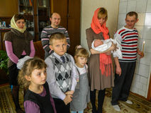 Orthodox infant baptism ceremony at home in Belarus. Stock Image