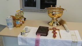 Orthodox cross with bible in church stock video