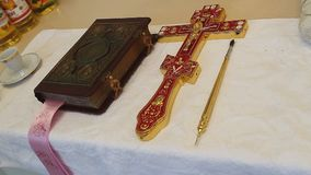 Orthodox cross with bible in church. Orthodox items. Orthodox cross with bible in church stock video
