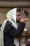 Orthodox Jew blow the shofar. Orthodox Jew blows the shofar in the synagogue before Rosh aShona Royalty Free Stock Photography