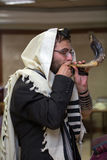 Orthodox Jew blow the shofar. Orthodox Jew blows the shofar in the synagogue before Rosh aShona Stock Photography