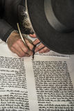 An orthodox jew hand writing a torah script Stock Photography