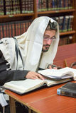 Orthodox Jew learns Torah. Orthodox Jew learns Talmud sitting in the synagogue Royalty Free Stock Images