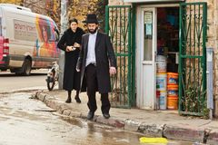 Orthodox Jewish man crosses the road in Jerusalem. JERUSALEM, ISRAEL - DECEMBER 29, 2016: The Orthodox Jewish man crosses the road near to a small shop at the Royalty Free Stock Photography