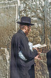 Orthodox jewish man prays at Royalty Free Stock Images