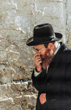 Orthodox jewish man prays at the Western Wall Stock Images