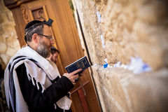 Orthodox Jewish man prays at western wall. Orthodox Jewish men pray at western wall on May 16, 2011. The Western wall is an important Jewish religious site Royalty Free Stock Images