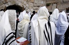 Orthodox Jewish men pray at the Western Wall  in Jerusalem Israe. Orthodox Jewish men Pray at the Western Wall during the Jewish holiday of Passover in Jerusalem Stock Photo