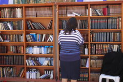 Orthodox Jewish Woman near Books of Torah at the W Stock Images