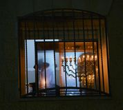 Orthodox jew lighting candles of hanukia during the jewish holiday of chanuka Stock Photos