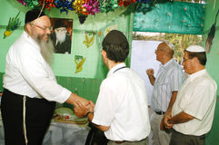 Orthodox Jews Celebrate Sukkot in a Sukkah Stock Photo
