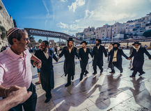 Orthodox Jews in Jerusalem. Jerusalem, Israel - October 22, 2015. Group of Orthodox Jews dances next to ancient limestone wall known as Wailing Wall in the Old Stock Photo