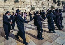 Orthodox Jews in Jerusalem. Jerusalem, Israel - October 22, 2015. Group of Orthodox Jews dances next to ancient limestone wall known as Wailing Wall in the Old Royalty Free Stock Photos