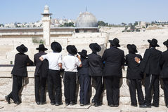 Orthodox Jews stand in front of the Western Wall. Orthodox Jews from Yeshiva stand in front of the Western Wall. In the old city of Jerusalem Stock Photo