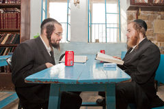 Orthodox jews study the bible in jerusalem. Two orthodox hassidic jews study the bible in jerusalem Royalty Free Stock Images