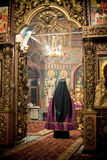 Orthodox liturgy with bishop Mercury in Moscow. MOSCOW - MARCH 13: the priest prays in sanctuary during the Orthodox liturgy with bishop Mercury in High Stock Image