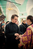 Orthodox liturgy with bishop Mercury in Moscow. MOSCOW - MARCH 13: The monk recieves communion during Orthodox liturgy with bishop Mercury in High Monastery of Stock Photography