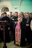 Orthodox liturgy with bishop Mercury in Moscow. MOSCOW - MARCH 13: The priest reads the Bible circled by people during Orthodox liturgy with bishop Mercury in Royalty Free Stock Photo