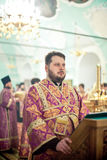 Orthodox liturgy with bishop Mercury in Moscow. MOSCOW - MARCH 13: The priest stands in front of lectern during the Orthodox liturgy with bishop Mercury in High Royalty Free Stock Image
