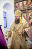 Orthodox liturgy with bishop Mercury in Moscow. MOSCOW - MARCH 13: the bishop in gold clothes walks with a burninig candle during the Orthodox liturgy with Stock Photos
