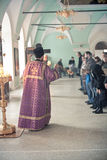 Orthodox liturgy with bishop Mercury in Moscow. MOSCOW - MARCH 13: one priest burns incense during Orthodox liturgy with bishop Mercury in High Monastery of St Stock Photo