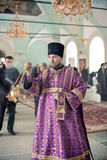 Orthodox liturgy with bishop Mercury in Moscow. MOSCOW - MARCH 13: one priest burns incense during Orthodox liturgy with bishop Mercury in High Monastery of St Stock Image