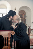 Orthodox liturgy with bishop Mercury in Moscow. MOSCOW - MARCH 13:  One priest kisses a hand of the bishop during Orthodox liturgy with bishop Mercury in High Stock Photography