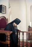Orthodox liturgy with bishop Mercury in Moscow. MOSCOW - MARCH 13: The bishop droops his head in prayer during Orthodox liturgy in High Monastery of St Peter in Stock Photo