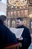 Orthodox liturgy with bishop Mercury in Moscow. MOSCOW - MARCH 13: One priest holds the Gospel during the bishop reads it during Orthodox liturgy  in High Stock Photography