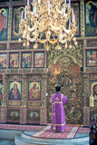 Orthodox liturgy with bishop Mercury in Moscow. MOSCOW - MARCH 13: One priest reads the prayer in front of iconostasis during Orthodox liturgy with bishop Stock Images