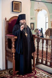 Orthodox liturgy with bishop Mercury in Moscow. MOSCOW - MARCH 13: The bishop blesses monks during orthodox liturgy with bishop Mercury in High Monastery of St Stock Photography