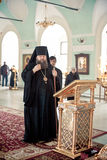 Orthodox liturgy with bishop Mercury in Moscow. MOSCOW - MARCH 13: The bishop Mercury crosses himself during orthodox liturgy  in High Monastery of St Peter in Royalty Free Stock Photo